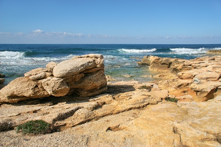 View on coastal yellow rocks on the shore of Mediterranean sea at Rosh HaNikra reserve in Israel  photo