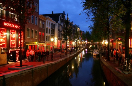 amsterdam canal: AMSTERDAM - JULY 16: Famous Red Light District at evening in Amsterdam, Netherlands.
