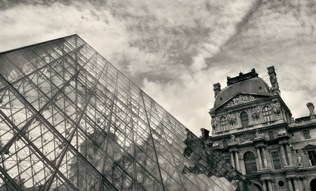 PARIS - JULY 06: Fragment of famous modern Pyramid in Louvre museum in Paris, France (sepia toned).