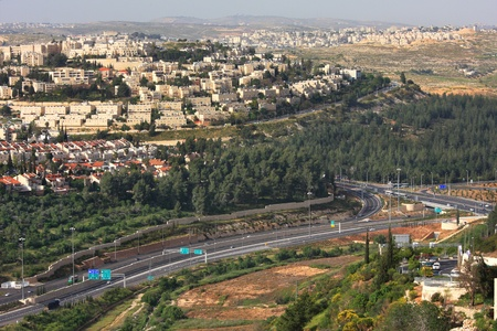 israeli: Aerial view on highway among hills and city quarters of Jerusalem, Israel  Stock Photo