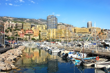View on marina with yachts and boats and residential buildings on background in Monte Carlo, Monaco Stock Photo - 12951391