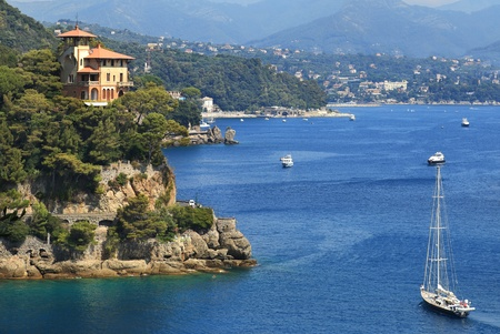 Yacht a sailing along coastline of Portofino on Ligurian sea, Northern Italy  Stock Photo - 12958059
