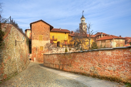 Old historic houses and paved street among old walls in town of Saluzzo, northern Italy. Stock Photo - 13214368