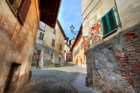 saluzzo: Narrow paved street among old historic houses in Saluzzo, northern Italy