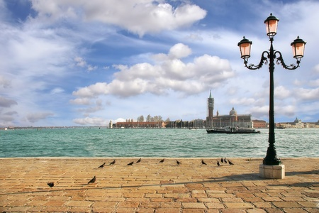 maggiore: View on Grand Canal and San Giorgio maggiore church from promenade with traditional lamppost in Venice, Italy