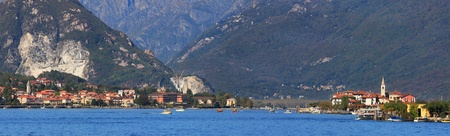 borromeo: Panoramic view on famous Lake Maggiore,small lakeside town of Stresa and Isola dei Pescatori in Northern Italy  Stock Photo