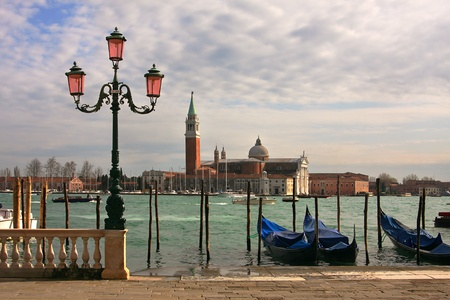 maggiore: Venetian lamppost, gondolas on Grand Canal and San Giorgio Maggiore Church in Venice, Italy  Stock Photo