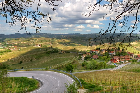 small country town: View on road towards small town on the hills of Piedmont in Northern Italy