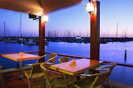 east espresso: Outdoor restaurant at sunset on Marina in Ashqelon, Israel  Stock Photo