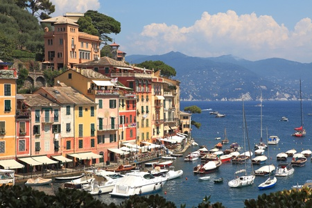 View on famous town of Portofino with small bay full of yachts and boats on Ligurian sea, northern Italy  photo