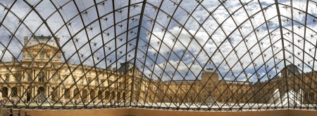 PARIS - JULY 2007: Panoramic view on famous Louvre museum from inside of glass pyramid on July 2007 in Paris, France.