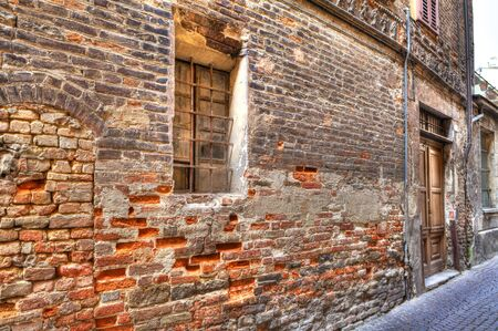 Ancient brick wall of old historic house in Alba, northern Italy Stock Photo - 13733637