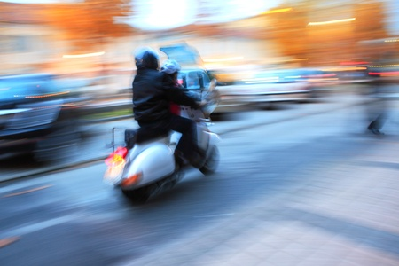 Abstract photo of motorcycle moving on the street