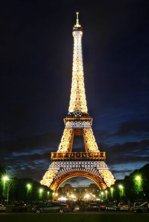 PARIS - JULY 07: Famous Eiffel Tower at evening with night illumination in Paris, France on July 07, 2007.