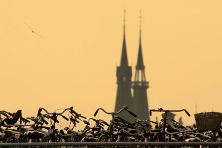 dutch landmark: Bicycles parking in front of old church in Amsterdam, Netherlands  Stock Photo