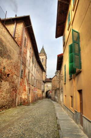 Vertical oriented image of narrow paved street among old historic houses in Saluzzo, northern Italy Stock Photo - 14291047