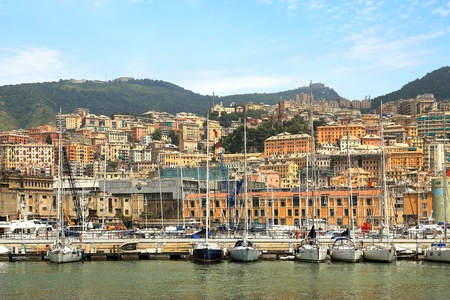 View on harbor with boats and yachts and buildings on the hills on background in city of Genoa, Italy. Stock Photo - 14510867