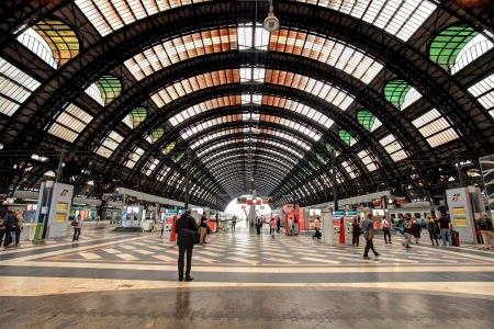 railroad station platform: MILAN - JUNE 07: Milan Central Station (aka Milano Centrale) interior view. Milano Centrale is the main railway station of Milan and one of the main railway stations in Europe. It was opened in 1931 and serves national and international routes in Milan, I