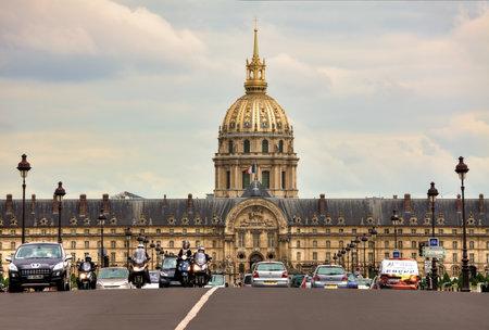 tumb: PARIS - JUNE 06: Traffic on Alexander III bridge near Les Invalides complex containing museums, monuments, veteran hospital and tumb of Napoleon Bonaparte in Paris, France on June 06, 2012.