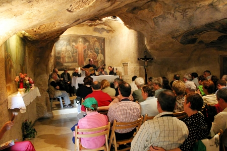 JERUSALEM - MAY 26: Pilgrims during mass inside the Grotto of Gethsemane (aka the Grotto of the Betrayal) - the place where Jesus betrayed by Judas, was arrested. Grotto  became a pilgrimage site since the 4th century in Jerusalem, Israel on May 26, 2004. Stock Photo - 14628326