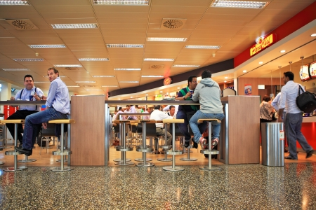 MILAN - SEPTEMBER 21: Unidentified people sitting in restaurant at Malpensa International Airport - largest airport in northern Italy serves international and domestic flights in Milan, Italy on September 21, 2010.