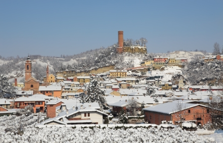 Houses, churches and ancient castle tower in small town of Corneliano D photo