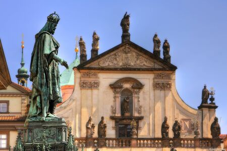 Famous statue of King Charles IV in front of old church near Charles Bridge in Prague, Czech Republic  photo