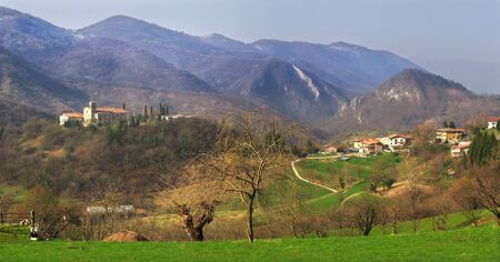italian village: Panoramic view on small village among the mountains in northern Italy.