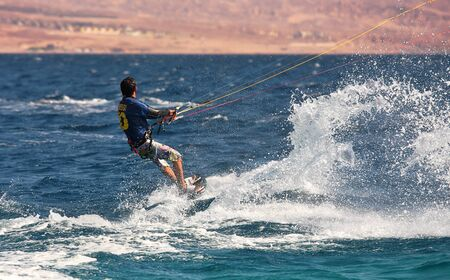 EILAT, ISRAEL - MARCH 31: Unidentified kitesurfer glides on water surface on Red Sea March 31, 2010 in Eilat Israel. Stock Photo - 15156129