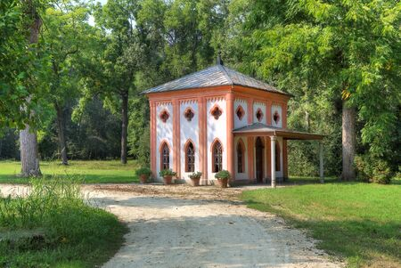 racconigi: Small guest house along footpath among trees at Racconigi park in Northern Italy  Editorial
