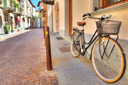City bicycle on the cobbled street of Alba in Piedmont, Northern Italy  photo