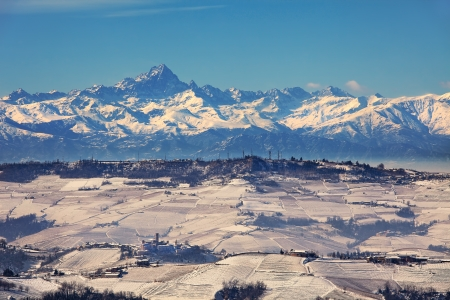 Aerial view on snowy hills and mountain peaks on background at winter in Piedmont, Italy  photo