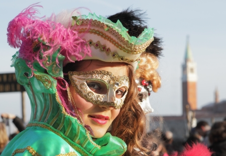 VENICE, ITALY - MARCH 04: Unidentified participant wear traditional mask and costume during famous Venetian Carnival on March 04, 2011 in Venice, Italy. Stock Photo - 17146462