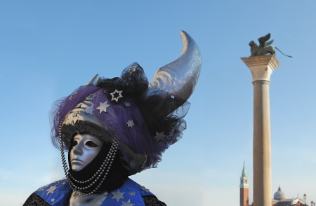 VENICE, ITALY - MARCH 04: Unidentified participant wear traditional mask and costume during famous Venetian Carnival on March 04, 2011 in Venice, Italy. Stock Photo - 17147126