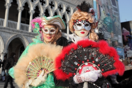 VENICE, ITALY - MARCH 04: Unidentified participants wear traditional mask and costume during famous Venetian Carnival on March 04, 2011 in Venice, Italy. Stock Photo - 17147131