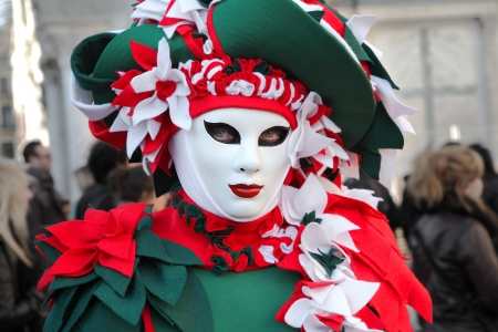 VENICE, ITALY - MARCH 04: Unidentified participant wear traditional mask and costume during famous Venetian Carnival on March 04, 2011 in Venice, Italy. Stock Photo - 17147136