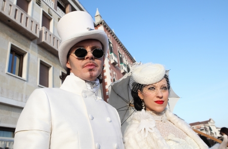 VENICE, ITALY - MARCH 04: Unidentified participants wear elegant vintage costumes during famous Venetian Carnival on March 04, 2011 in Venice, Italy. Stock Photo - 17147128