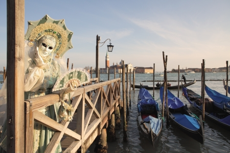 participant: VENICE, ITALY - MARCH 04: Unidentified participant wear traditionall mask and costume during famous Venetian Carnival on March 04, 2011 in Venice, Italy.