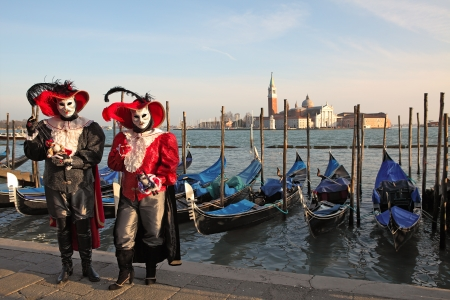 VENICE, ITALY - MARCH 04: Unidentified participants wear traditional mask and costume during famous Venetian Carnival on March 04, 2011 in Venice, Italy. Stock Photo - 17147134