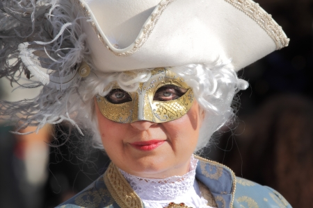 VENICE, ITALY - MARCH 04: Unidentified participant wear traditionall mask, wig and costume during famous Venetian Carnival on March 04, 2011 in Venice, Italy. Stock Photo - 17147129