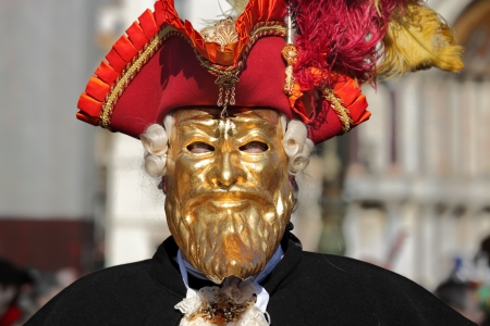 participant: VENICE, ITALY - MARCH 04: Unidentified participant wear traditional mask and costume during famous Venetian Carnival on March 04, 2011 in Venice, Italy.
