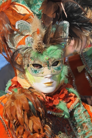 participant: VENICE, ITALY - MARCH 04: Unidentified participant wear traditionall mask and clothing during famous Venetian Carnival on March 04, 2011 in Venice, Italy.