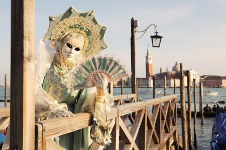 VENICE, ITALY - MARCH 04: Unidentified participant wear traditional mask and costume during famous Venetian Carnival on March 04, 2011 in Venice, Italy. Stock Photo - 17298821