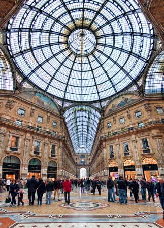 MILAN - NOVEMBER 15: Galleria Vittorio Emanuele II vertical oriented image - the oldest shopping mall housed within a four-storey and includes shops, restaurants and bars. Galleria named after first king of Italy and was originally designed in 1861 in Mil