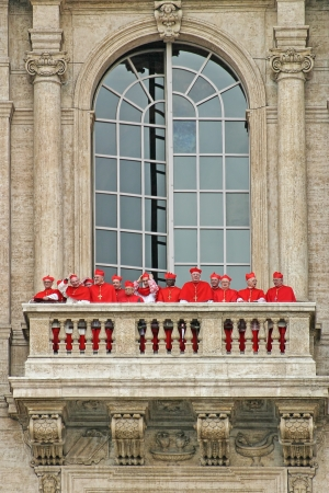 VATICAN - APRIL 19: Cardinals wearing red suits on the balcony of Saint Peter's Basilica after election of new Pope. Election procedure also known as papal conclave or meeting of the College of Cardinals in Vatican on April 19, 2005.