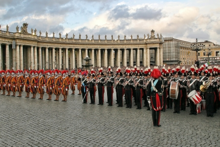 VATICAN - APRIL 19: Pontifical Swiss guards and military band stand on Saint Peter's Square during new pontific elections in Vatican city, Vatican on April 19, 2005. Stock Photo - 17403461