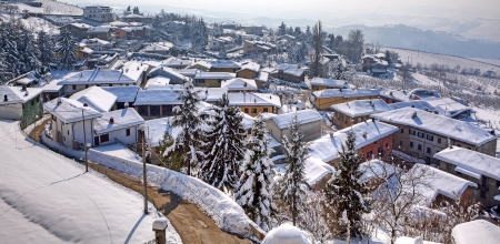 Panorama on small town, road among houses and roofs covered by snow at Diano D Stock Photo - 17621908
