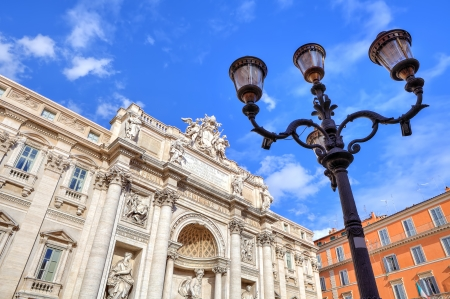 Traditional lamppost and fragment of famous Trevi Fountain under blue sky in Rome, Italy Stock Photo - 17731729