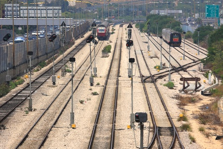 Two trains on the tracks at a railway junction in the centre of Tel Aviv, Israel  photo