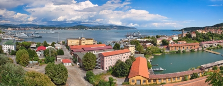 Panorama of navy base on gulf of La Spezia under beautiful blue sky with white clouds on Mediterranean sea in Italy  photo